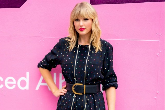 "BROOKLYN, NY - AUGUST 23: Taylor Swift poses in front of a mural introducing her latest album ""Lover"" on August 23, 2019 in in the Brooklyn borough of New York City. (Photo by Gotham/GC Images)"