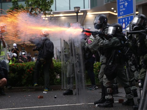 Hong Kong police fire water cannon at protesters for first time during clashes