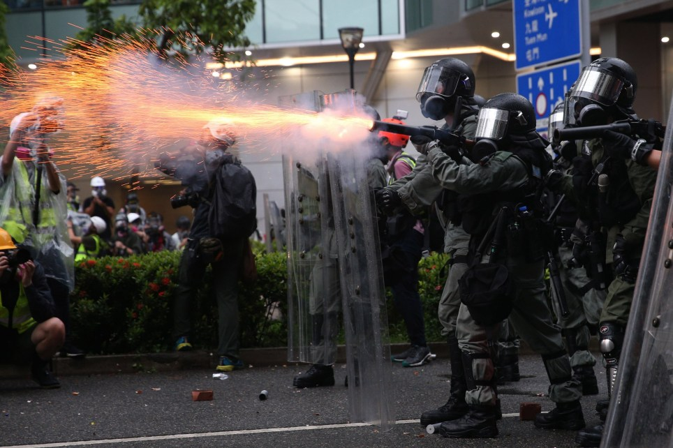 epa07792156 Riot police fire tear gas as protesters take part in an anti-government rally in Kwai Fung and Tsuen Wan, Hong Kong, China, 25 August 2019. The protests were triggered last June by an extradition bill to China, now suspended, and evolved into a wider anti-government movement with no end in sight. EPA/JEROME FAVRE