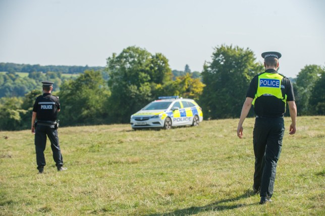 The scene where a light aircraft crashed (note plane cannot be seen from police tape). 25 August 2019. See SWNS story SWBRplane; Two people have died after a light aircraft crashed into a field. The pilot and the passenger were the only two people on board when the plane crashed yesterday afternoon (Saturday) in Stonor, near Henley, Oxon. Thames Valley Police received reports of the crash at about 2.10pm and officers remain at the scene, while fire and ambulance services also attended. The two people were pronounced dead at the scene, and nobody on the ground was injured. Their next of kin have been informed. The Air Accidents Investigation Branch has been informed and police say they are assisting with its initial investigation.