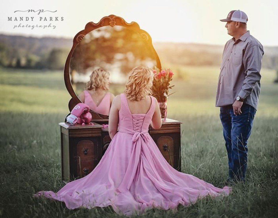 Kelsey and wife Charlie standing near dressing table outside in a field