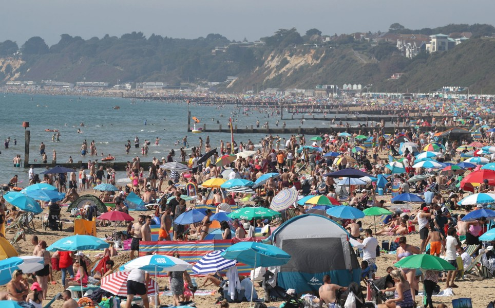 People enjoy the warm weather on Bournemouth beach in Dorset. PRESS ASSOCIATION Photo. Picture date: Monday August 26, 2019. See PA story WEATHER Hot. Photo credit should read: Andrew Matthews/PA Wire