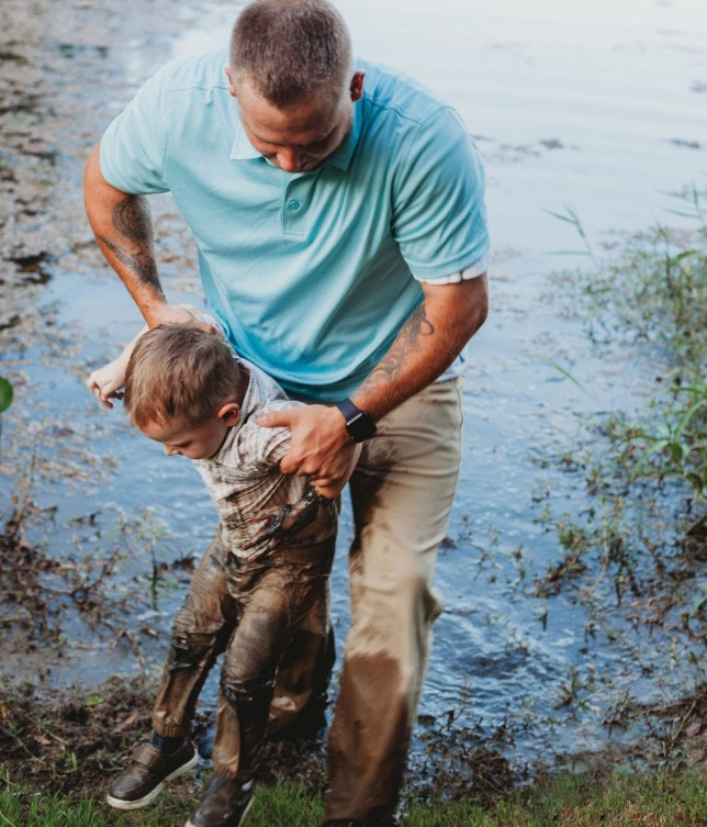 Pic By Jasmine Tamlin / CATERS NEWS (PICTURED: Lincoln Mizzles in mud. ) - A naughty toddler interrupted his family's photoshoot by diving shoulder-deep into a muddy lake. Two-year-old Lincoln Mizzles, from Flint, Texas, became bored of the summertime photoshoot his family was having on July 23 with photographer Jasmine Tamlin, and decided to add some action to it. Flint ran away from mum and dad and jumped inside a muddy lake, spattering his clothes with mud and bringing the session to a sudden end. Dad Matthew, 24, had to dive in the lake himself to bring the naughty boy back to shore. - SEE CATERS COPY