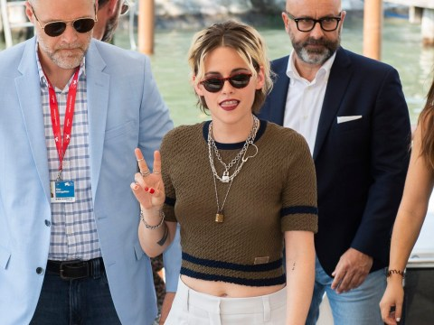 Kirsten Stewart throws up peace sign as she arrives in Venice ahead of Seberg premiere