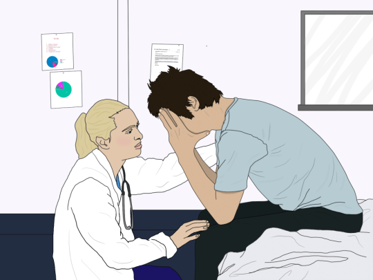 A doctor comforts a man with his head in his hands