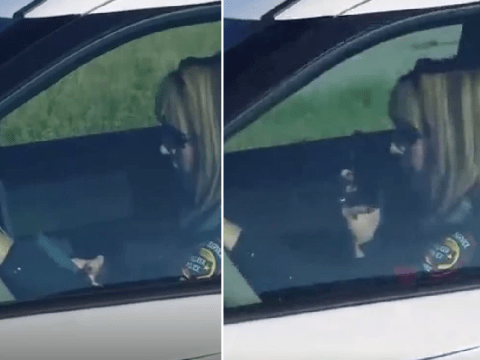 Uniformed police officer caught texting while driving her patrol car with no seat belt on