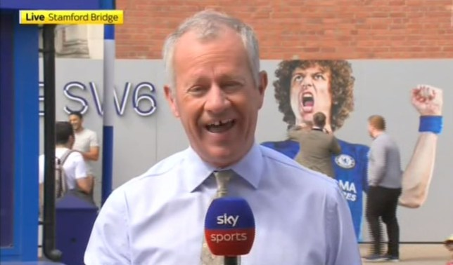 The Chelsea fan swung a few punches at the poster of Arsenal-bound David Luiz