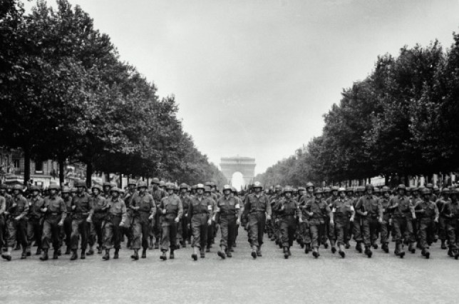 troops marching together in France during World War II