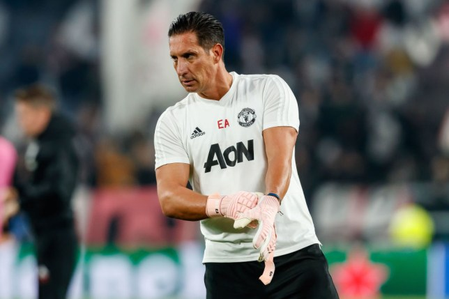 Emilio Alvarez puts on goalkeeper gloves before Manchester United's game against Juventus