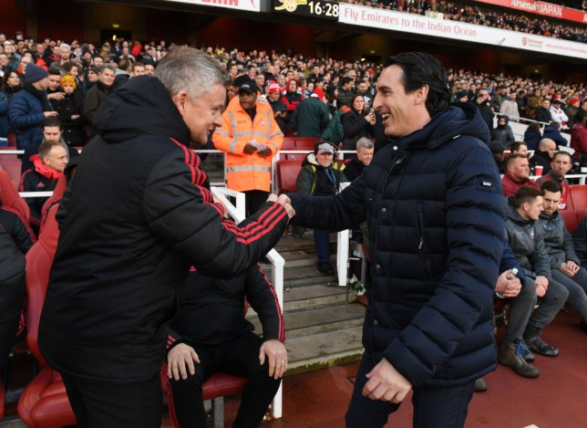 Ole Gunnar Solskjaer shakes hands with Unai Emery