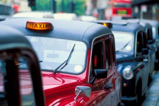 Black cabs in a queue
