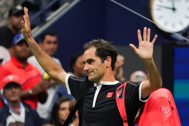 Roger Federer waves goodbye to the US Open crowd after a surprise defeat