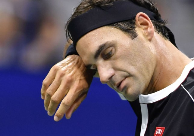 Roger Federer mops his brow during a shock US Open exit to Grigor Dimitrov