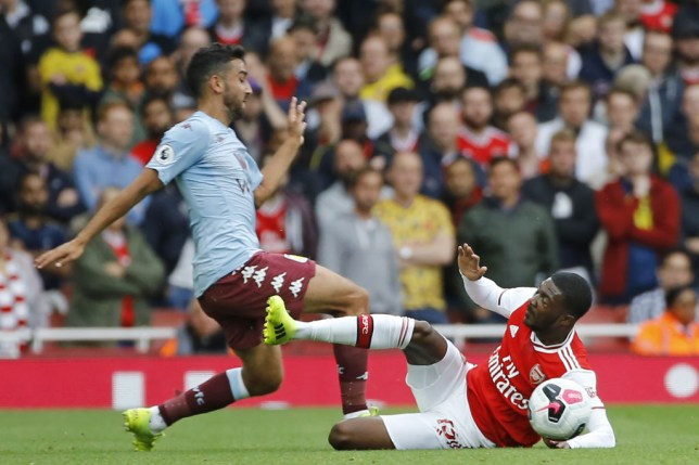 Arsenal's English midfielder Ainsley Maitland-Niles (R) receives a second yellow card for this foul on Aston Villa's Welsh defender Neil Taylor (L) during the English Premier League football match between Arsenal and Aston Villa at the Emirates Stadium in London on September 22, 2019. (Photo by Tolga AKMEN / AFP) / RESTRICTED TO EDITORIAL USE. No use with unauthorized audio, video, data, fixture lists, club/league logos or 'live' services. Online in-match use limited to 120 images. An additional 40 images may be used in extra time. No video emulation. Social media in-match use limited to 120 images. An additional 40 images may be used in extra time. No use in betting publications, games or single club/league/player publications. / (Photo credit should read TOLGA AKMEN/AFP/Getty Images)