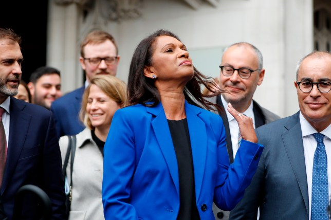 Gina Miller swishes her hair outside the Supreme Court