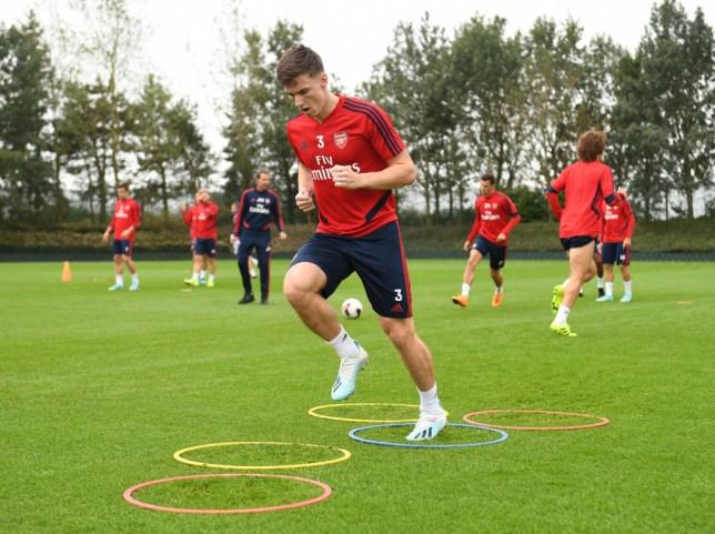 Kieran Tierney nutmegs Shkodran Mustafi in first training session for Arsenal