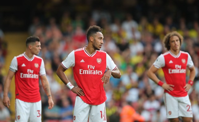 Arsenal players look despondent after drawing against Watford