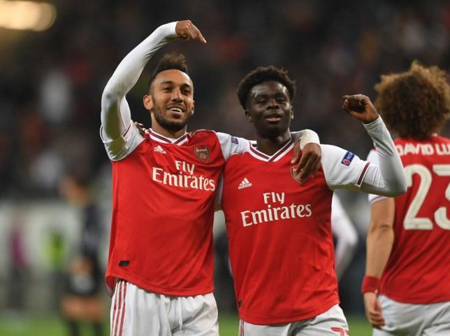 Pierre-Emerick Aubameyang celebrates with Bukayo Saka