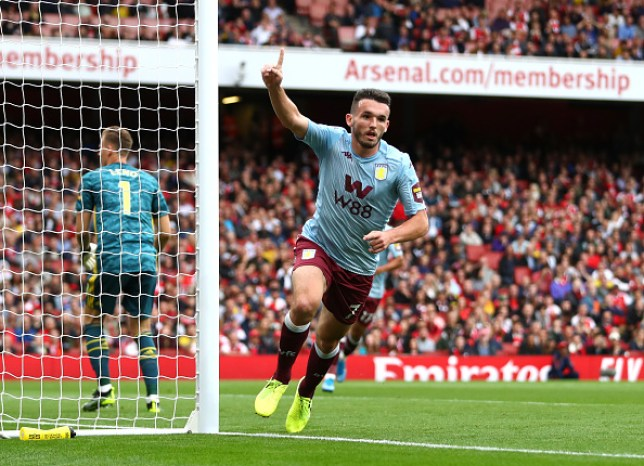 John McGinn celebrates after scoring for Aston Villa against Arsenal