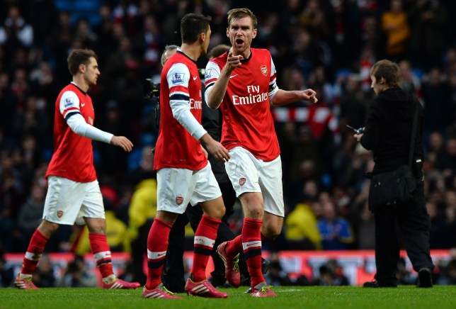 Per Mertesacker and Mesut Ozil famously clashed after Arsenal's defeat to Manchester City in late 2013