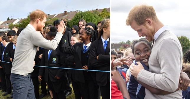 Prince Harry high fives school children on rugby visit