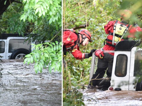 Three stuck on top of Land Rover as UK lashed by heavy rain
