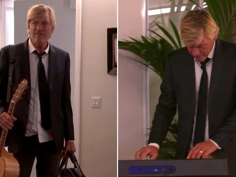 Richard Madeley trips over as he arrives at The Circle 'prison' flat with his guitar