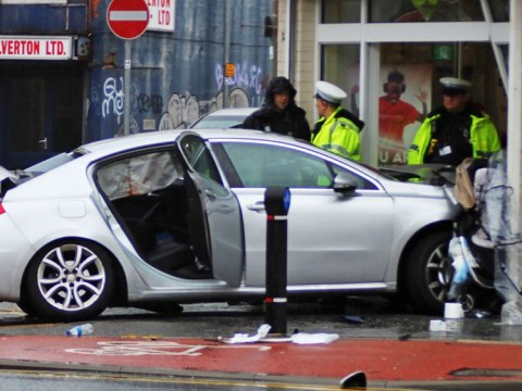 Seven injured as car ploughs into church leaving baby's buggy pinned to wall