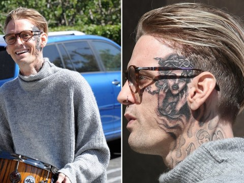 Aaron Carter doesn't look like he's regretting giant Rihanna face tattoo at all