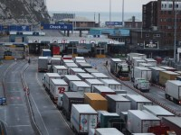 """(FILES) In this file photo taken on March 19, 2018 Lorries queue up at the port of Dover on the south coast of England on March 19, 2018. - British Prime Minister Boris Johnson has spent his first weeks in office ramping up preparations for a no-deal Brexit on October 31, but faces assessments it could be economically calamatous for the country. Johnson ordered government departments to """"turbo-charge"""" contingency planning after taking power on July 24, 2019 promising """"all necessary funding"""" beyond the ??4.2 billion (4.6 billion euros, $5.1 billion) already allocated. But an analysis of the potential impact of a no-deal depature carried out by the government, and leaked August 18, 2019 to a newspaper, makes for grim reading. It predicts Britain will face shortages of fuel, food and medicine, a three-month meltdown at its ports, a hard border with Ireland and rising costs in social care. (Photo by Daniel LEAL-OLIVAS / AFP)DANIEL LEAL-OLIVAS/AFP/Getty Images"""