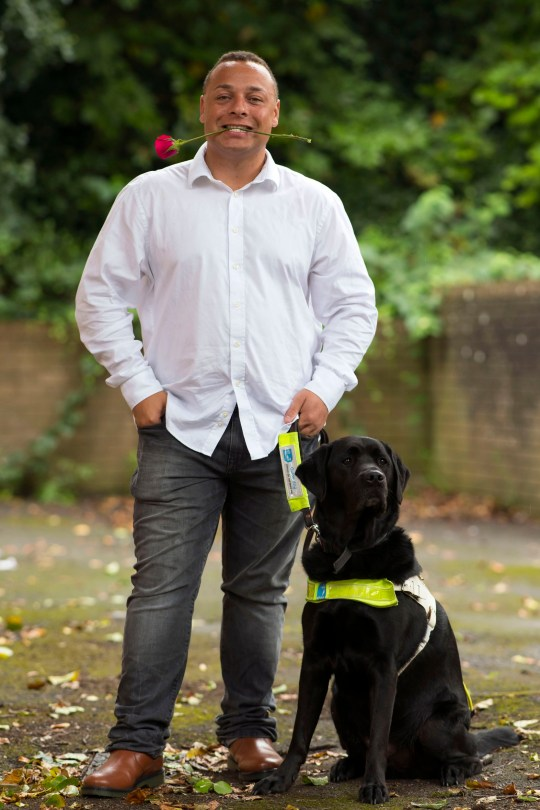 Daniel with his guide dog
