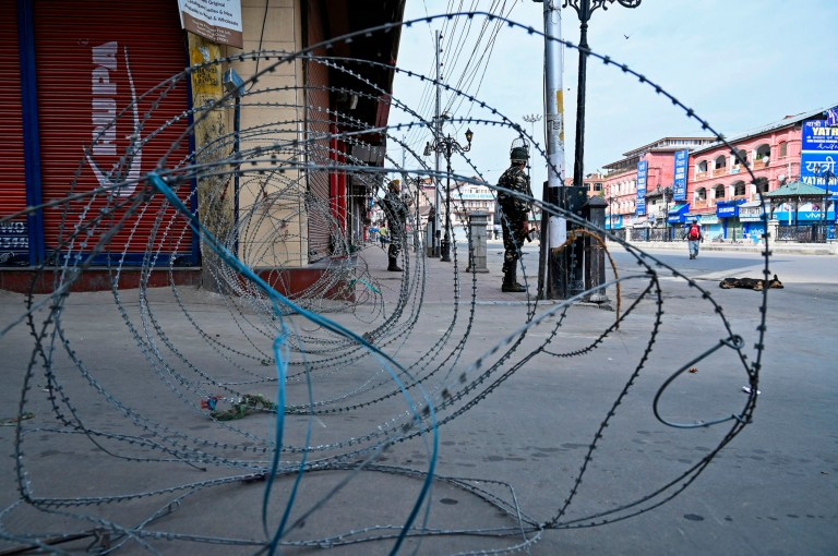 TOPSHOT - Security personnel stand guard on a street in Srinagar on August 30, 2019. - Thousands rallied across Pakistan on August 30 in mass demonstrations protesting Delhi's actions in Indian-administered Kashmir in the most ambitious public protests targeting India in years. (Photo by Tauseef MUSTAFA / AFP)TAUSEEF MUSTAFA/AFP/Getty Images