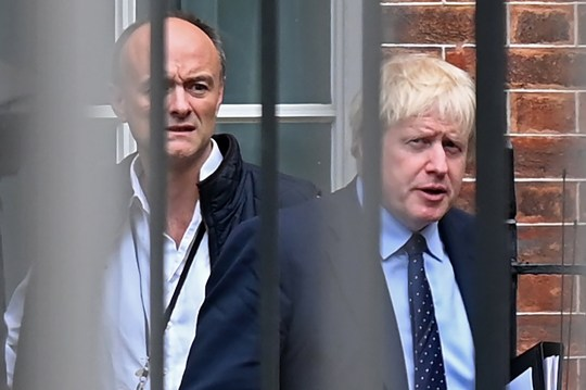 Britain's Prime Minister Boris Johnson (R) and his special advisor Dominic Cummings leave from the rear of Downing Street in central London on September 3, 2019, before heading to the Houses of Parliament. - The fate of Brexit hung in the balance on Tuesday as parliament prepared for an explosive showdown with Prime Minister Boris Johnson that could end in a snap election. Members of Johnson's own Conservative party are preparing to join opposition lawmakers in a vote to try to force a delay to Britain's exit from the European Union if he cannot secure a divorce deal with Brussels in the next few weeks. (Photo by DANIEL LEAL-OLIVAS / AFP)DANIEL LEAL-OLIVAS/AFP/Getty Images