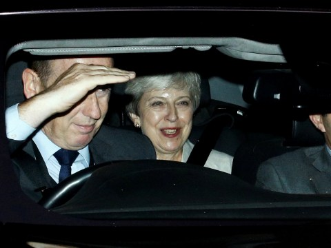 Theresa May leaves Parliament with a smile after Boris Johnson's humiliating defeat