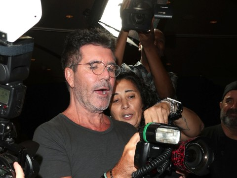 Simon Cowell on the rampage as he grabs a camera at the America's Got Talent semi-final