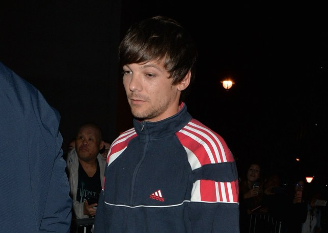 Louis Tomlinson stopped wearing skinny jeans after One Direction to 'protect his b******s'