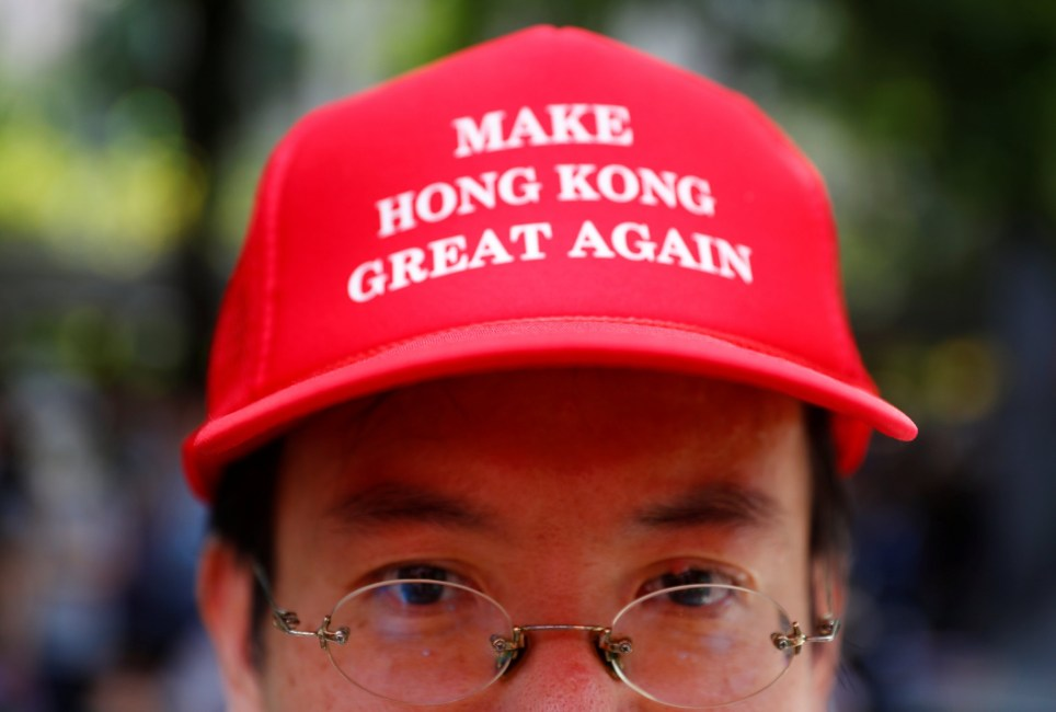 "A protester is seen wearing a cap that reads, ""Make Hong Kong Great Again"" in Central, Hong Kong, China September 8, 2019. REUTERS/Kai Pfaffenbach"