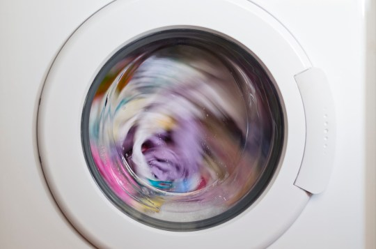 Washing machine door with rotating garments inside