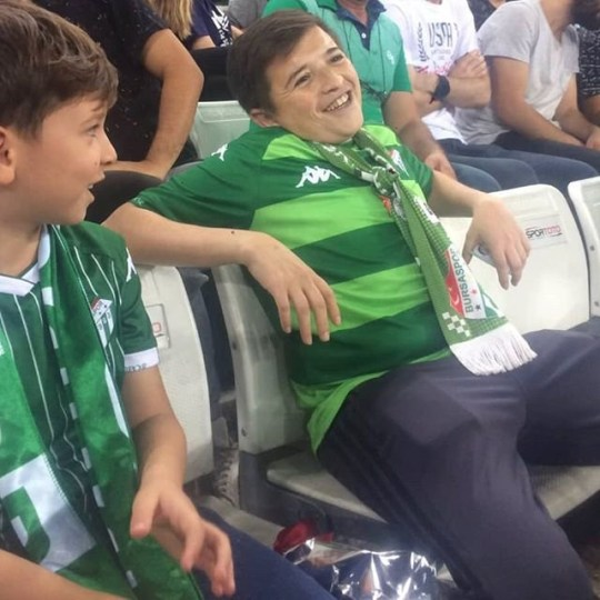 """TWITTER exploded after a """"young boy"""" was spotted smoking during a friendly match that was organised to raise funds for cancer. However, it has been reported the youngster that got football fans in spin actually turned out to be fresh-faced father who was nearing 40. The incident occurred after Turkish clubs Bursaspor and Fenerbahce decided to take advantage of the international break by arranging a game. And with both teams enjoying a strong backing, they agreed that all proceeds from the showdown would be donated to organisations that fight against diseases such as leukaemia as well as foundations that support kids with Down Syndrome and autism. All seemed well until the camera panned among the crowd and appeared to capture a youngster puffing away on a cigarette. The fan, seated next to a child, did not have a care in the world as he enjoyed several puffs before the camera panned away. Shocked viewers in Turkey quickly took to Twitter to share the clip as they searched for the kid?s identity. However, they would not have to wait long for him to be identified. Local reports claim the 'child' was in fact a 36-year-old Bursaspor supporter. The young-looking dad had in fact brought along his kid to the game as they witnessed the ?Green Crocodiles? claim a 2-1 win over Fenerbahce, according to a post on Yureginikoyortaya's Instagram account."""