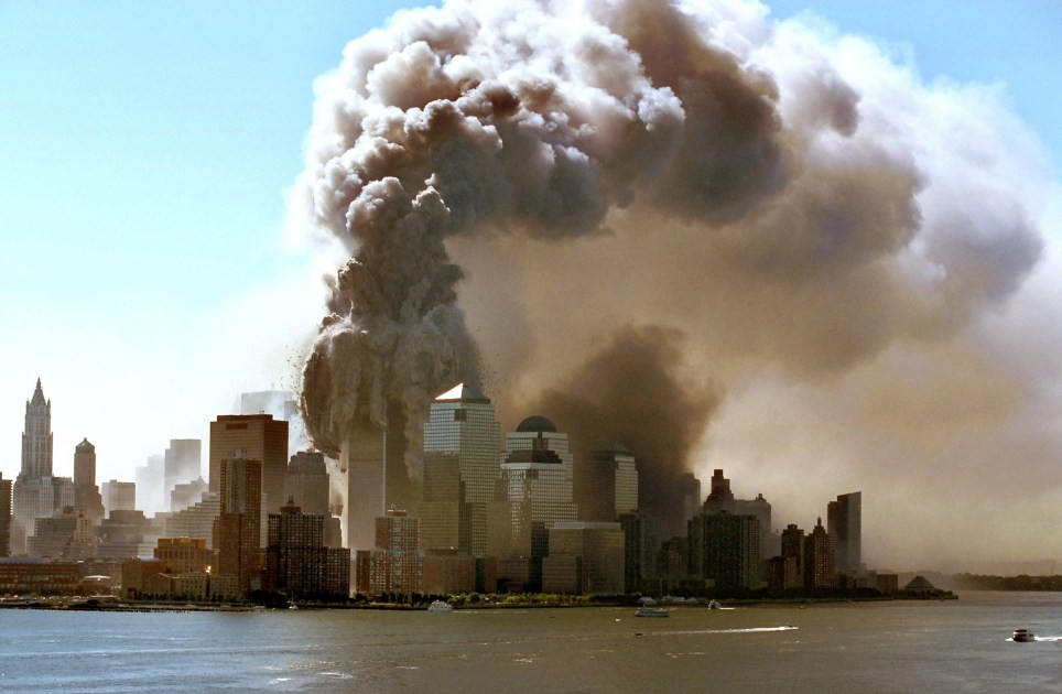 (dpa) - Clouds of smoke rise as the twin towers of the World Trade Center in New York crumble, 11.9.2001. The WTC skyscrapers collapsed following the suicide attacks of Islamic terrorists with highjacked planes, burying thousands of victims among the ruins. | usage worldwide