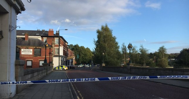 Blackburn Street in Radcliffe where a police cordon is in place, a baby was thrown into the River Irwell from a bridge. He was rescued by firefighters but is said to be in a critical condition