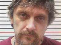 This undated booking photo provided by the Wayne County, Ill., Sheriff's Office shows William Wasmund. Wasmund, who rigged a shotgun to a rope attached to the door of a shed on his property in 2018 has been convicted of first-degree murder in the death of Jeff Spicer, who tried to enter the shed. The Southern Illinoisan reports that a Union County jury convicted Wasmund Thursday, in Jonesboro, Ill., of both first-degree murder and aggravated battery. (Wayne County Sheriff's Office via AP)