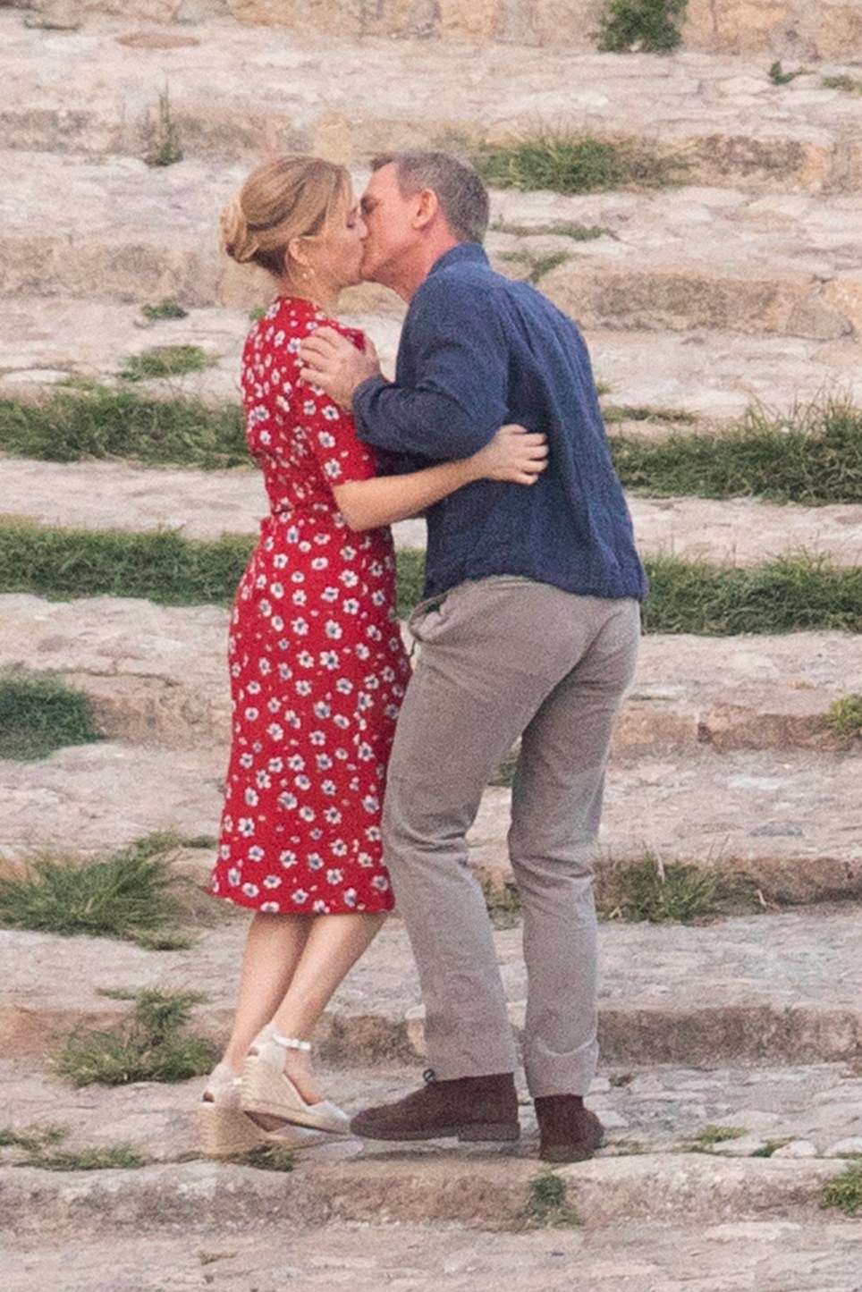 Daniel Craig shares a kiss and embrace with French co-star Lea Seydoux