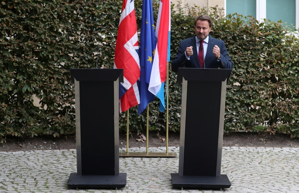 Luxembourg's Prime Minister Xavier Bettel spoke next to an empty podium