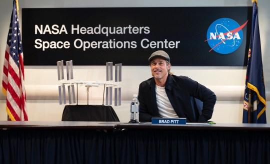 Brad Pitt speaks with NASA astronaut Nick Hague
