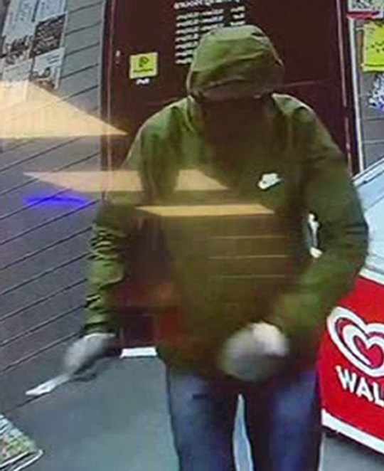 Handout CCTV images dated 16/9/2019 of masked robber during a robbery at the Express Supermarket in Worthing. An 11-year-old girl scared off the armed robber by throwing bread at him with her dad. PA Photo. Issue date: Tuesday September 17, 2019. The masked robber had pulled out a knife in a supermarket in Sussex, but left empty handed after being hit by the loaf and some bottles of squash. See PA story POLICE Worthing. Photo credit should read: Sussex Police/PA WireNOTE TO EDITORS: This handout photo may only be used in for editorial reporting purposes for the contemporaneous illustration of events, things or the people in the image or facts mentioned in the caption. Reuse of the picture may require further permission from the copyright holder.