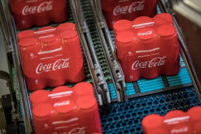 Shrink-wrapped packages of 6 aluminium cans of Coke soda move along the automated production line at the Coca-Cola Hbc Magyarorszag Kft plant in Dunaharaszti, Hungary, on Thursday, July 13, 2017. Coca-Cola is pushing to expand its non-soda offerings, but carbonated soft drinks still make up the majority of sales. Photographer: Akos Stiller/Bloomberg via Getty Images