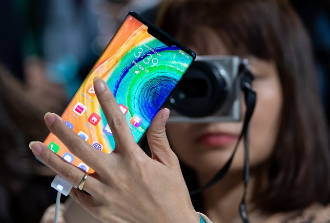 19 September 2019, Bavaria, Munich: A woman photographs the Huawei Mate 30 Pro smartphone after a Huawei press conference. Huwaii has introduced the new smartphone series Mate 30 / 30 Pro. Photo: Sven Hoppe/dpa