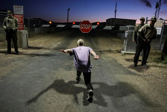 "A man poses as if he is going to ""Naruto run"" at an entrance to Area 51 as an influx of tourists responding to a call to 'storm' Area 51, a secretive U.S. military base believed by UFO enthusiasts to hold government secrets about extra-terrestrials, is expected in Rachel, Nevada, U.S. September 20, 2019. REUTERS/Jim Urquhart"