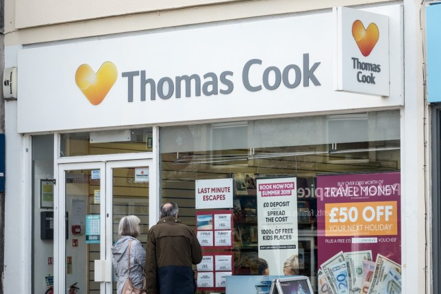 KEYNSHAM, ENGLAND - SEPTEMBER 24: People pass a branch of Thomas Cook holiday shop on September 24, 2018 in Keynsham, England. The travel agent Thomas Cook has blamed the summer heatwave for a drop in its annual profit forecast. (Photo by Matt Cardy/Getty Images)